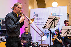 Photo: Musical entertainment was provided by the Blech Band Bamberg with Prof. Dr. Claus H. Carstensen (trombone), Prof. Dr. Guido Heineck (drums), Mark Perakis (trumpet), and Jakob Sehrig (tuba).